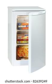White undercounter freezer full of various frozen foodstuff isolated on white.