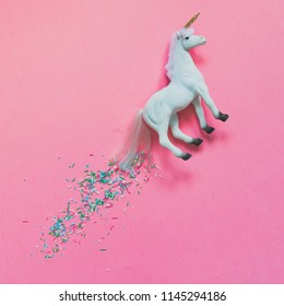 White unicorn flying with a train of confetti. Modern art concept. minimalism and candy style