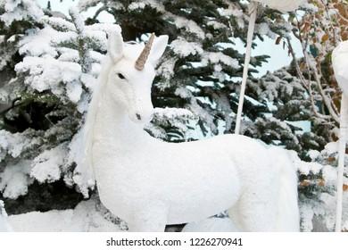 White unicorn in the snow