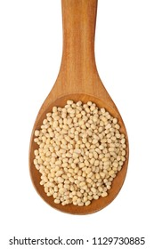 White urad in a wooden spoon isolated on white background