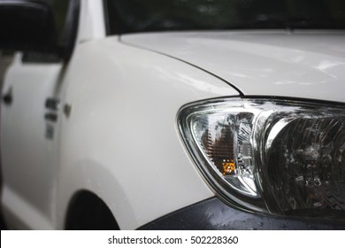white Ute Headlight Selective Focus Cloudy