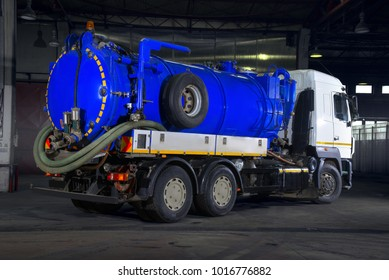White vacuum truck with blue tank in warehouse