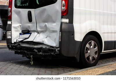 White van damaged after a rear-end collision when the other driver was not paying attention and did not brake