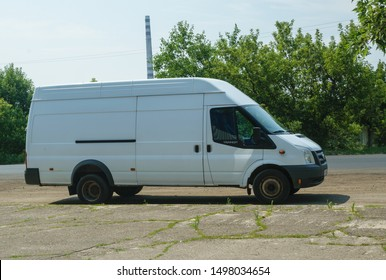 White van Ford Transit on the road. Kreminna, Ukraine 07.08.2019.