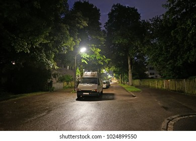 White van parked on road at night