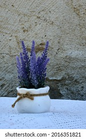 White vase with lavander on stone wall background. High quality photo