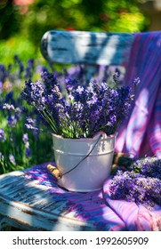 White vase with lavender bouquet on vintage chair, on lavender field background - Shutterstock ID 1992605909