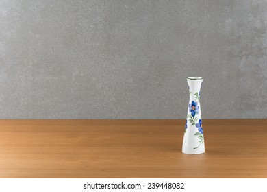 white vase on wood table