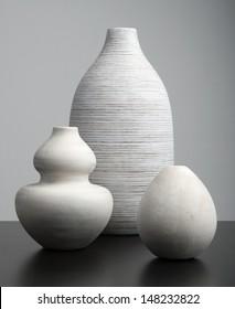 White Vases on a dark surface