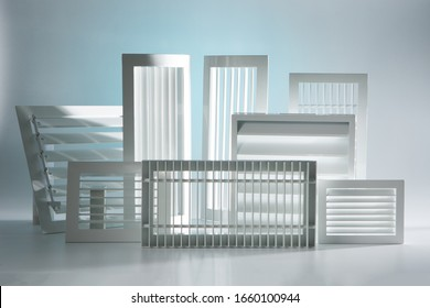 White ventilation grilles of different shapes and sizes. Demonstration of industrial ventilation grilles. Exhaust ventilation systems. White plastic grilles.