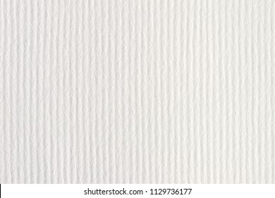 White  vertical striped embossed paper surface for background. White striped embossed paper texture.