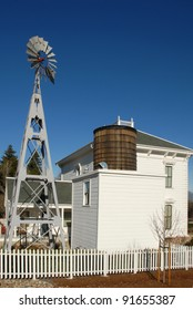 White Victorian Farm House Windmill and Water Tower