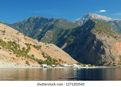 White village and its port of Agia Roumeli on the southeastern coast of Crete (Greece) between Chora Sfakion and Paleochora. In the background, the Samaria Gorge and the White Mountains or Lefka Ori.