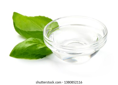 White Vinegar in glass bowl, close-up, isolated on white background.