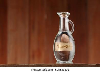 white vinegar on wooden background