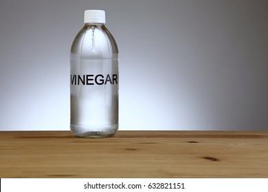 white vinegar on the wooden table