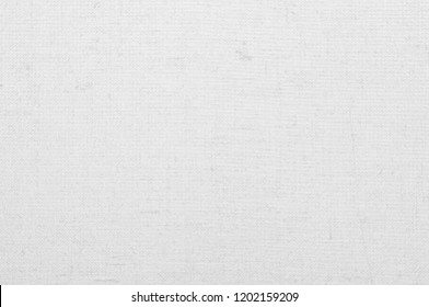 White vintage abstract Hessian or sackcloth fabric or hemp sack texture background. Wallpaper of artistic wale linen canvas. Blanket or Curtain of cotton pattern with copy space for text decoration.