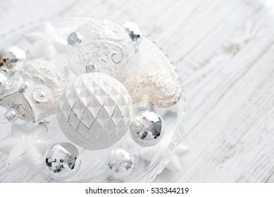White vintage christmas balls with christmas decorations on light background