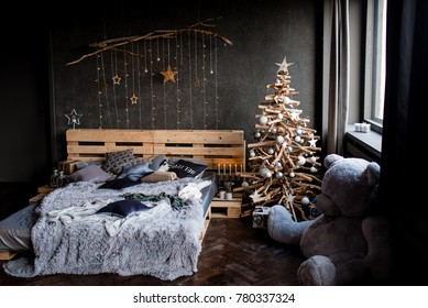 White vintage room, decorated for christmas with: pellets bed, tree with presents and toys, Christmas Balls, and big window