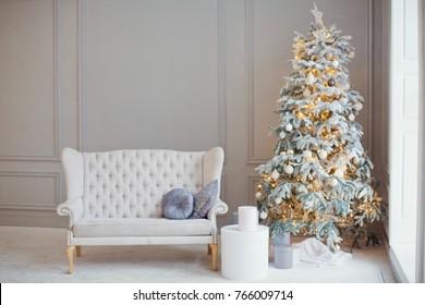 white vintage sofa and Christmas tree