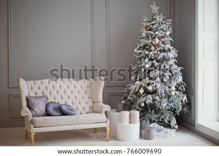 white vintage sofa and Christmas tree