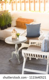 White vintage wooden table and chair set in morning sunlight