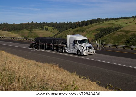 White Volvo Semi Truck Pulling Loaded Flatbed Stock Photo Edit Now
