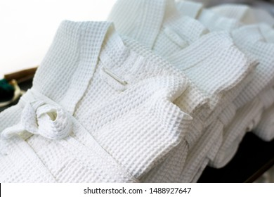 white waffle bathrobes for spa. bathrobes neatly folded in the hotel. Close up
