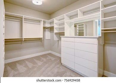 White Walk In Closet With Shelves, Drawers And Clothes Rails. Northwest, USA