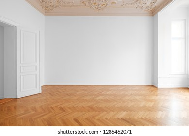 white wall background in empty apartment room , flat with wooden floor and stucco ceiling -