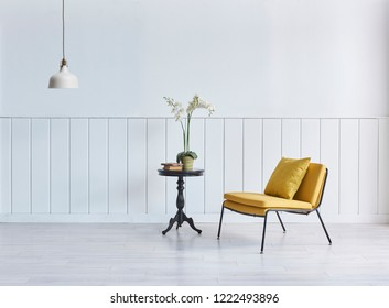 White wall background with wooden cabinet and armchair decoration living room concept with lamp.