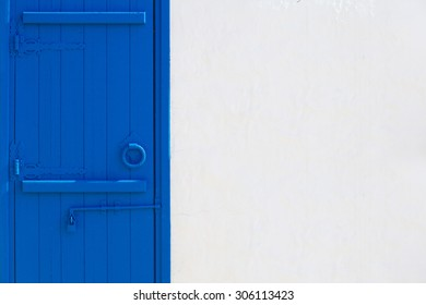 White Wall With Blue Door