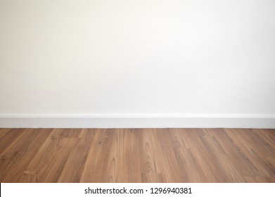 white wall and brown wood floor