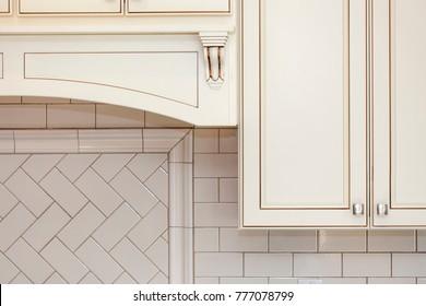 White wall cabinets and subway tile backsplash , vintage style cabinets