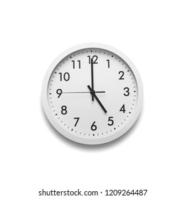 White wall clock isolated on white background. On the clock, five o'clock.