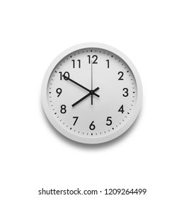 White wall clock isolated on white background. On the clock, eight on the clock.