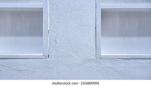 White wall with close up of white empty shelves, copy space, backplate
