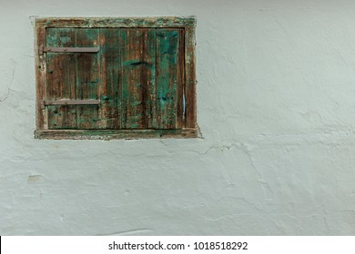 White wall with closed window