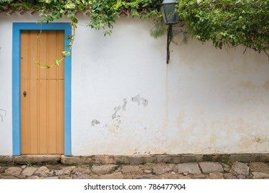 White wall with colored door, Paraty, Brazil