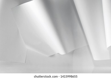 a white wall with curved paper attached to it. - Shutterstock ID 1415998655