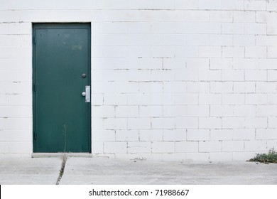 white wall dark green door