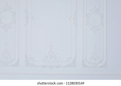 white wall are decorated with baroque ornaments