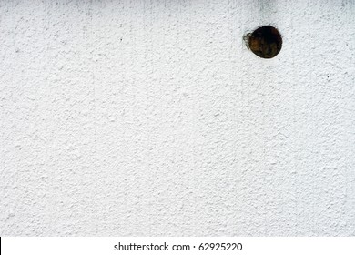 white wall with a hole background