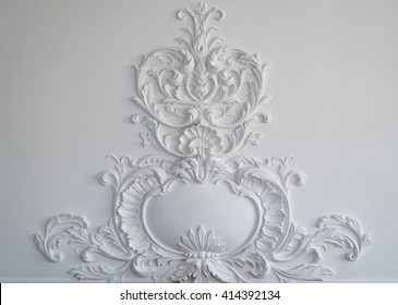 White wall molding with geometric shape and vanishing point. Horizontal. Luxury white wall design bas-relief with stucco mouldings roccoco element