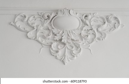 White wall molding with geometric shape and vanishing point. Luxury white wall design bas-relief with stucco mouldings roccoco element