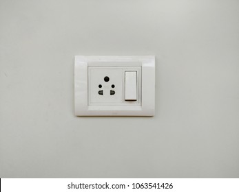 White wall socket on wall, electric socket with one button, Power outlet on white wall, 3 pin & 2 pin