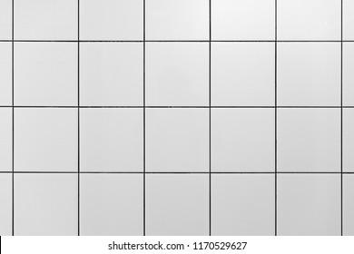 White wall tiles in gym shower. Minimal design