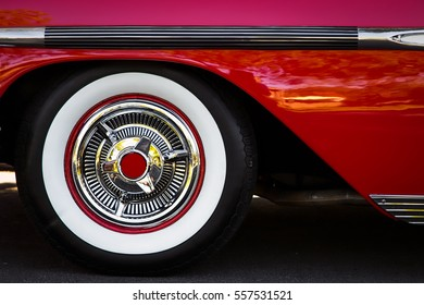 The white wall tires of a classic car sitting on a California street.