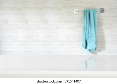 white wall with towel blurred background and white deck top place