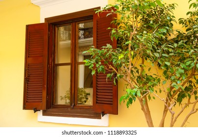 White wall, wooden door and window. Traditional european architecture